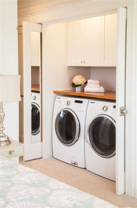closet washer and dryer basement exercise room with mirrored pocket doors