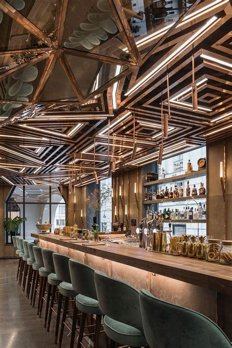 Innovative Bar Design by Luxury Bar Design Featuring Geometric Brass Ceiling Panels