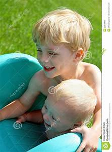 Big Baby Slide : brothers playing on slide outside stock photo image of ~ A.2002-acura-tl-radio.info Haus und Dekorationen