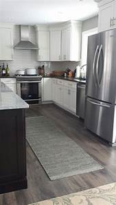 Best laminate flooring for kitchen pictures small room for Laminate floors in kitchen