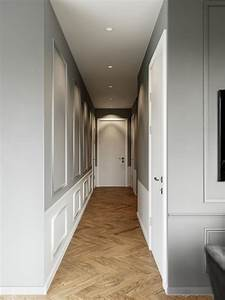 Grey-and-white-paneled-modern-home-hallway-design-ideas-with-chevron-floors