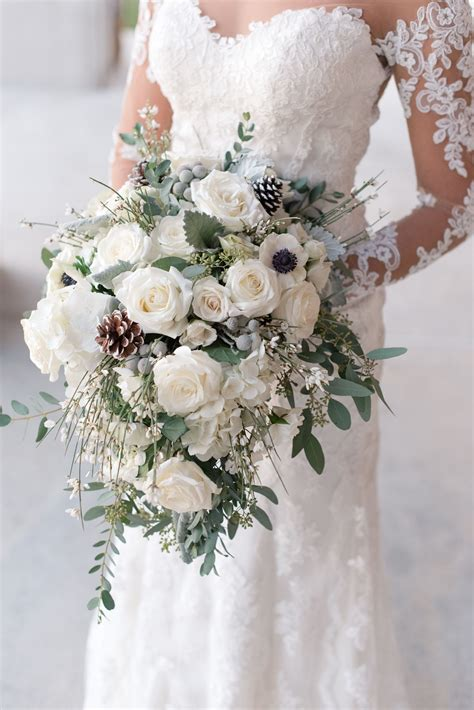 wintery white rose pine cone  silver brunia bouquet