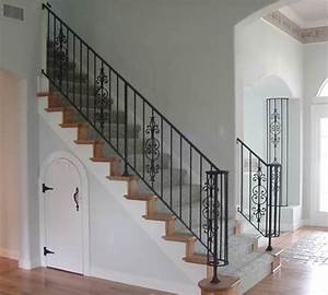 Interior wrought iron stair rail and column cover with