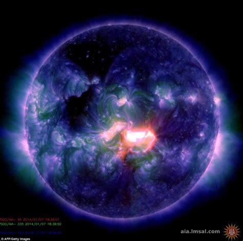 Sun unleashes massive solar flare SEVEN times the size of ...