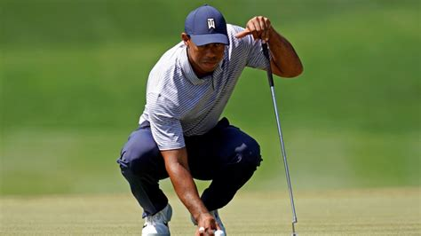 LOOK: Tiger Woods escapes the bushes with crazy left ...
