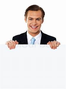 Cool businessman holding a blank poster | Stock Photo ...