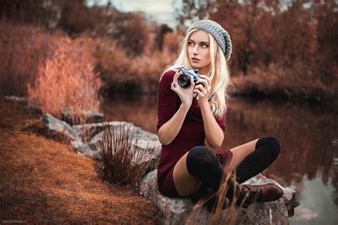 camera blonde red dress leggings hat nature pond