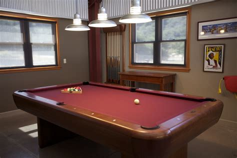 hanging lights around pool set galvanized barn pendants shine on family pool table