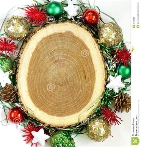 stump decorated with christmas ornaments royalty free