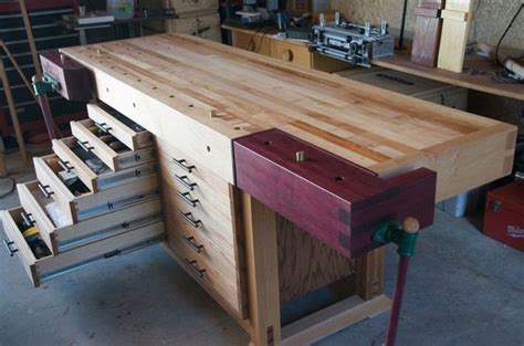 beautiful modified roubo workbench  tool storage