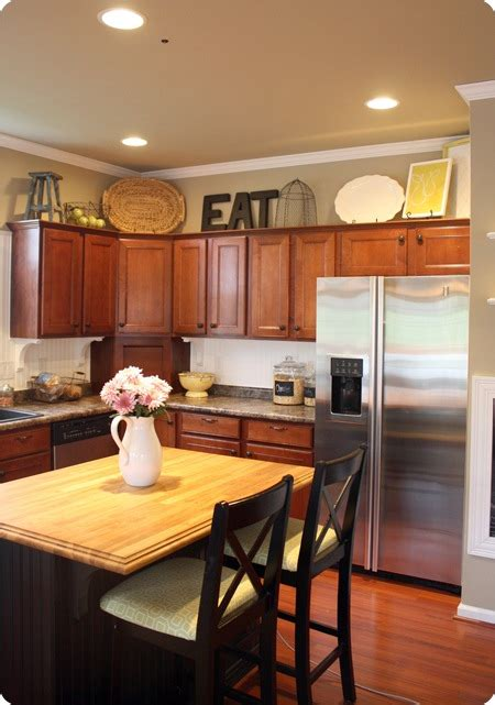 how to decorate above kitchen cabinets from thrifty decor