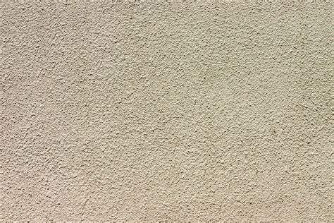 covering wallpaper with textured paint appealing texture