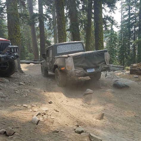 jeep scrambler pickup truck spied  roading   rubicon autoevolution
