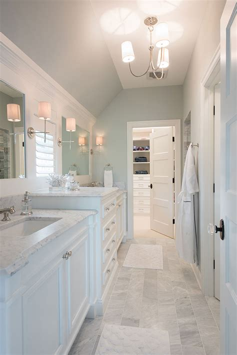 pretty master bathroom with soft blue gray walls marble