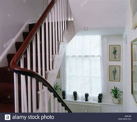 Mahogany Banister by Mahogany Rail And White Banisters On White Staircase Stock
