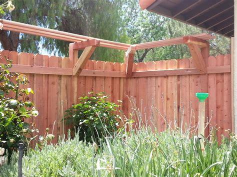 board  board redwood fence   trellis  wisteria