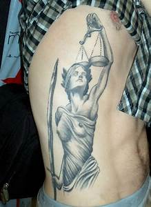 Lady Justice And Scales Tattoo On Rib