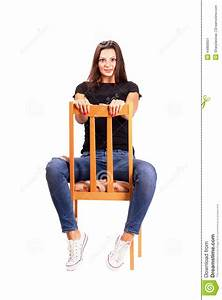 Woman Sitting Backwards On The Chair Posing Looking At ...