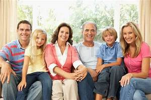 Extended Family Relaxing At Home Together Stock Photo