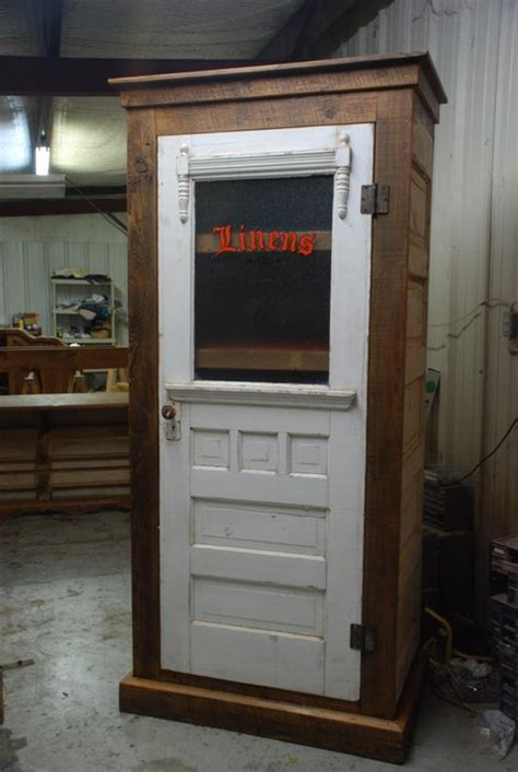 Linen cabinet made from old doors   by sweedking
