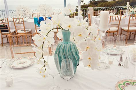 White Orchid Wedding Centerpiece With Turquoise Vase