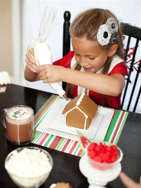 host  kid friendly gingerbread house decorating party hgtv