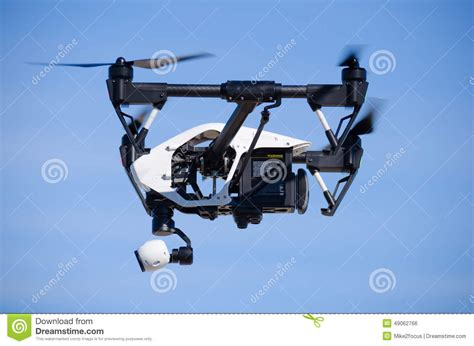 inspire  drone flying side view closeup editorial photo image