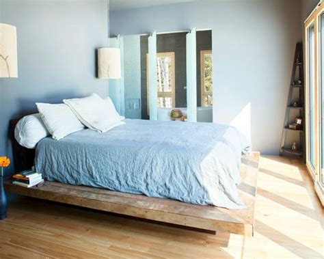 contemporary bedroom  untreated wooden bed frame