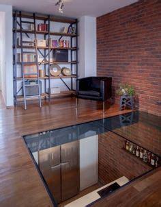verri 232 re de toit et puits de lumi 232 re dans un duplex dalle de verre dalles et le sol
