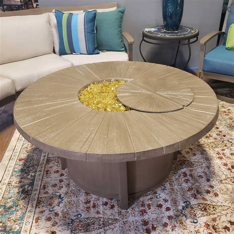 """Combining a fire pit with a coffee or dining table marries the best of both worlds into a focal piece that invites friends and family to relax and settle in for a night of great food and conversation. Castelle Altra 49"""" Round Fire Pit Coffee Table Fire & Heat ..."""