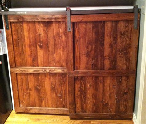 barn door kitchen cabinets barn door distressed wood cabinet by the yellow peony