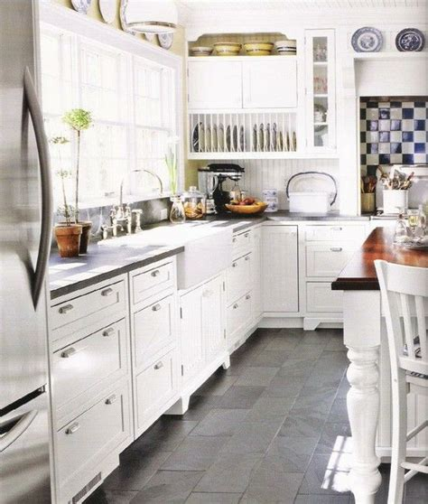 white kitchen cabinets with tile floor 25 best ideas about slate kitchen on slate 2088