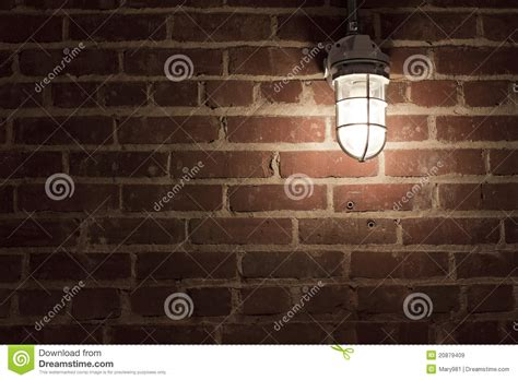 creepy light on textrued brick wall stock
