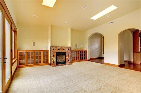 large empty room  fireplace  shelves  luxury home interior stock photo image