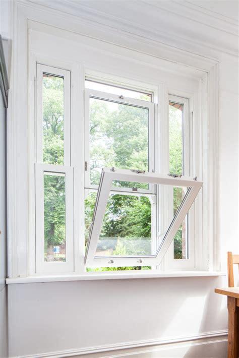 pvc vertical sliding windows  tilt option kat