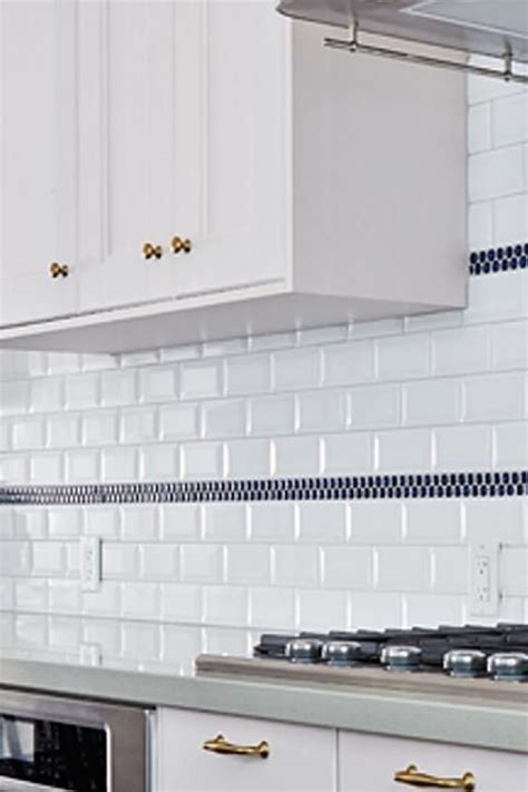 Subway tile with navy penny round stripes. Globe and Mail