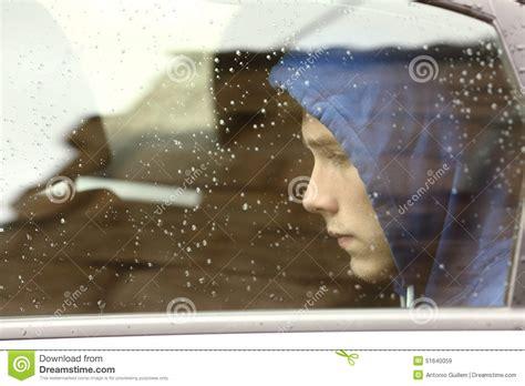 Sad Teenager Boy Worried Inside A Car Stock Image