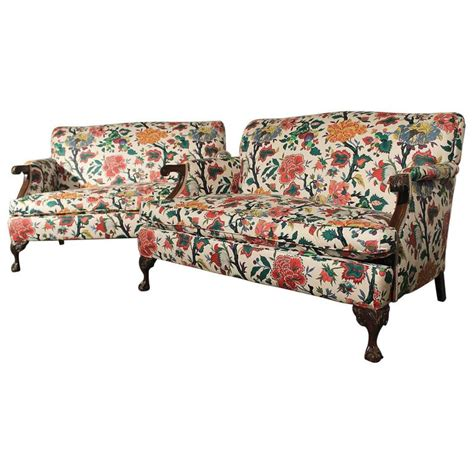 antique bold and bright club style floral loveseat