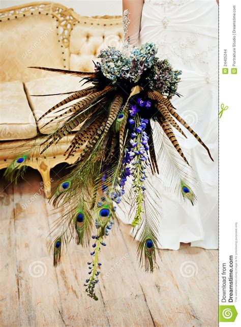 wedding bouquet  peacock feathers stock photo image
