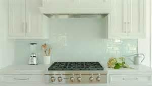 backsplash for white kitchen cabinets white kitchen cabinets with blue glass tile backsplash transitional kitchen