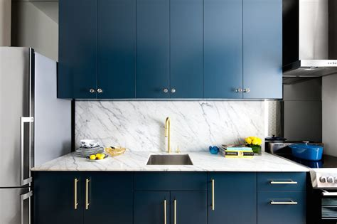 kitchen faucet toronto gorgeous kitchen features navy cabinets paired with statuarietto vintage marble countertops and