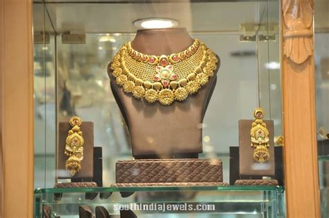 gold choker necklace set from pc jeweller ux ui designer choker and choker necklaces