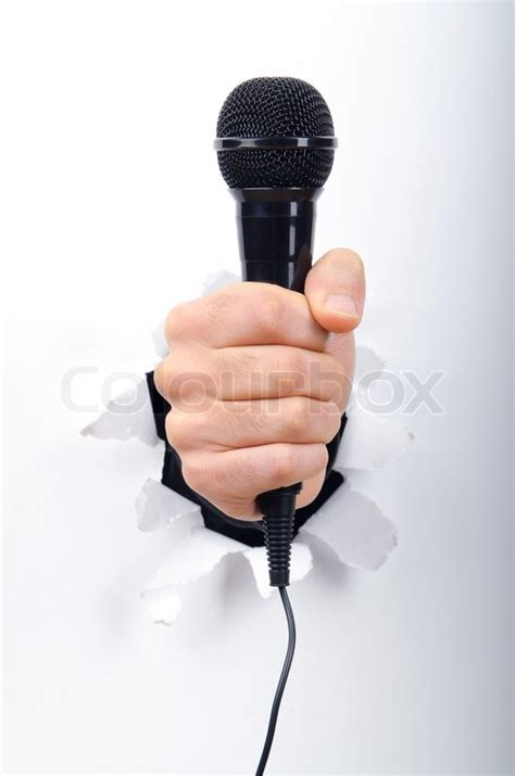hand holding microphone  hole  paper stock
