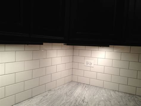 light gray quartz countertops light gray grout with brick pattern white subway tile back