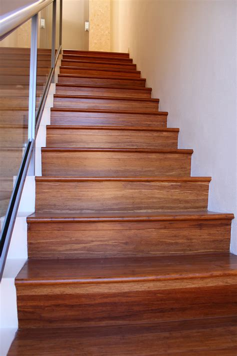 vinyl flooring on stairs vinyl wood plank flooring on stairs with glass railings and stainless steel handrail ideas