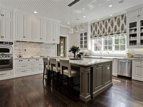 white kitchen with gray island grey backsplash white kitchen grey island neutral 1835