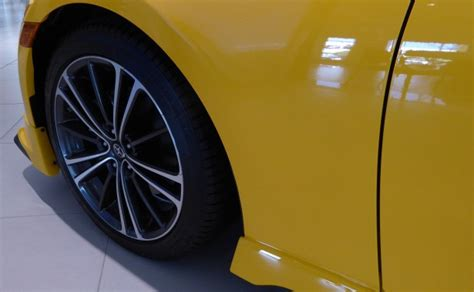 New Yellow Car Tire And Rim Free Stock Photo