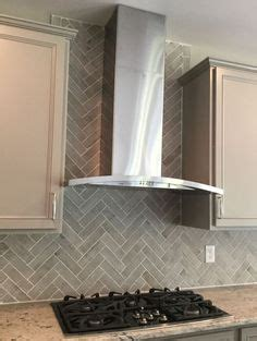 how to put tile on wall in the kitchen sand river pebbles wall tile exles in 2018 9928