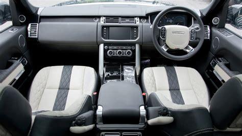 kahn   ivory black interior   range rover vogue
