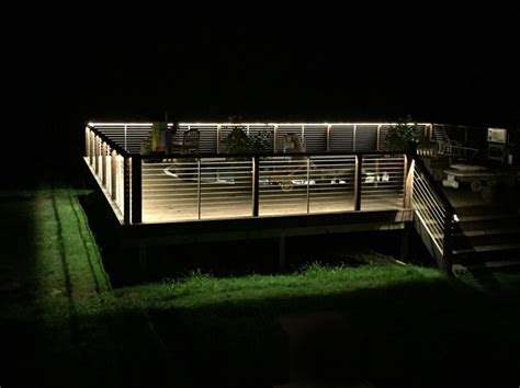 an exterior deck perimeter is illuminated using ribbon
